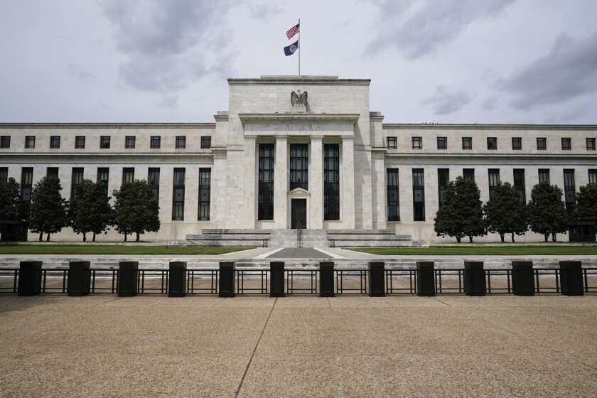 FILE - In this May 4, 2021, file photo is the Federal Reserve in Washington. The Federal Reserve's latest nationwide business survey found that the economy strengthened further in late May and early June, despite supply-chain bottlenecks that led to price hikes. The Fed said Wednesday, July 14, 2021 that seven of its 12 regional bank districts reported strong price increases, with the other five reporting moderate gains in prices. (AP Photo/Patrick Semansky, File)