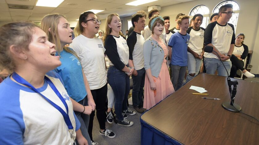 Burbank High School Choir members sing during a special meeting to decide the future of the Burbank