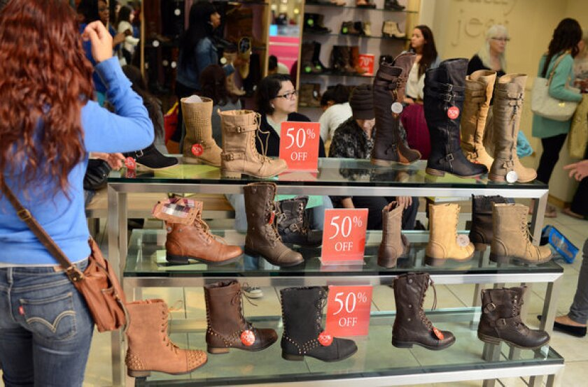 Retail sales up 4.5% in December; merchants say discounts hurt