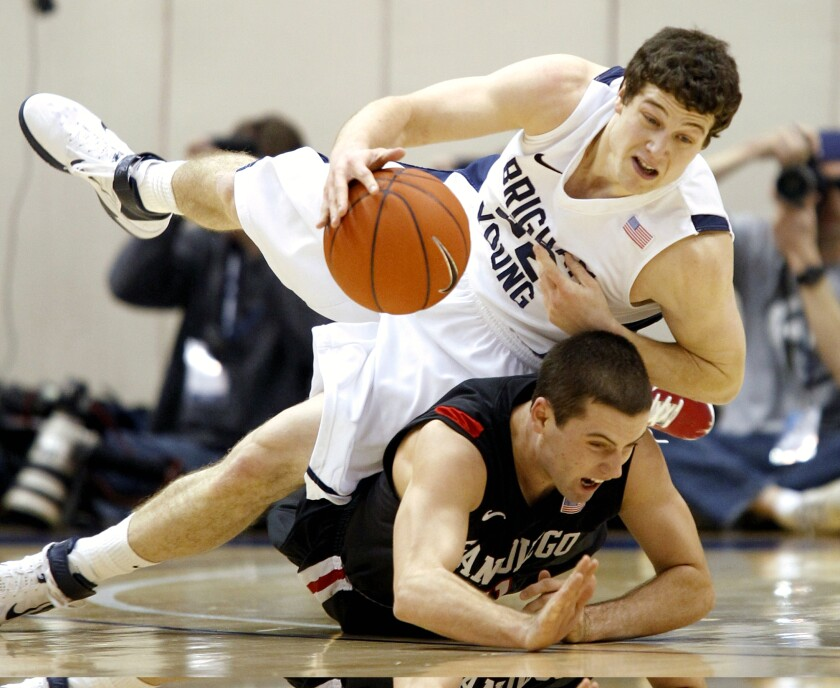 BYU's Jimmer Fredette, who scored 43 points, is fouled by San Diego State's James Rahon during Aztecs-Cougars game on Jan. 26, 2011 in Provo, Utah.