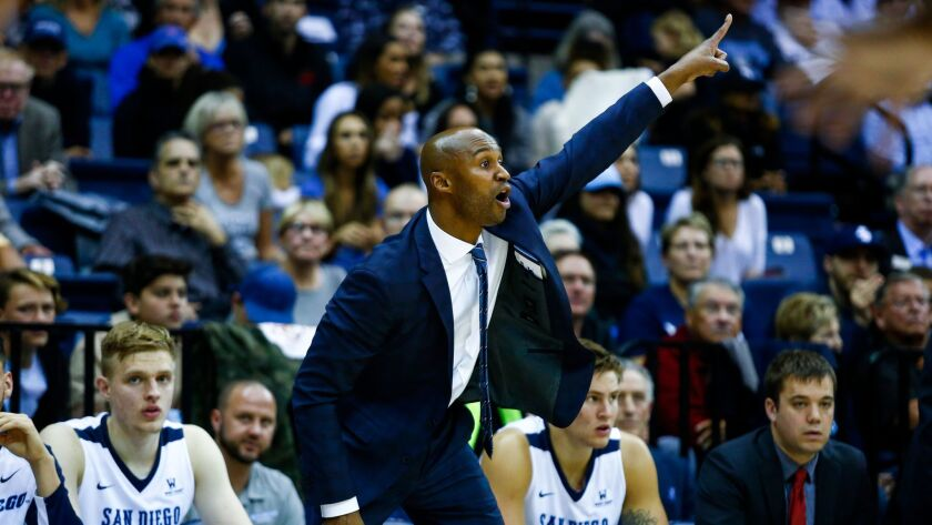 USD head coach Lamont Smith motions from the sidelines as the Toreros defend against Gonzaga in the second half.