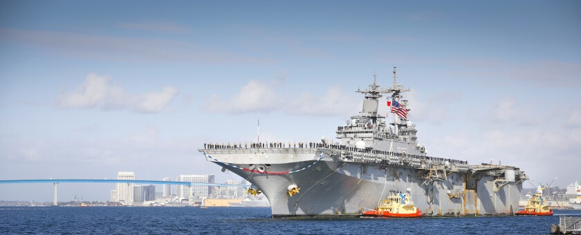 The USS Boxer, the flagship of the Boxer Amphibious Ready Group arrives at Naval Base San Diego, ending a seven-month deployment, November 27, 2019.