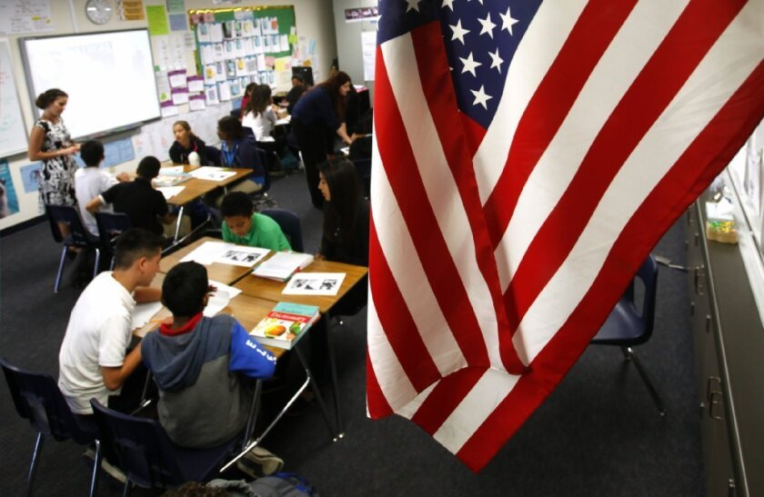 Hearings begin Monday in a lawsuit claiming that California's teacher tenure and protection laws violate students' constitutional rights. Above, students work in a Santa Ana classroom.