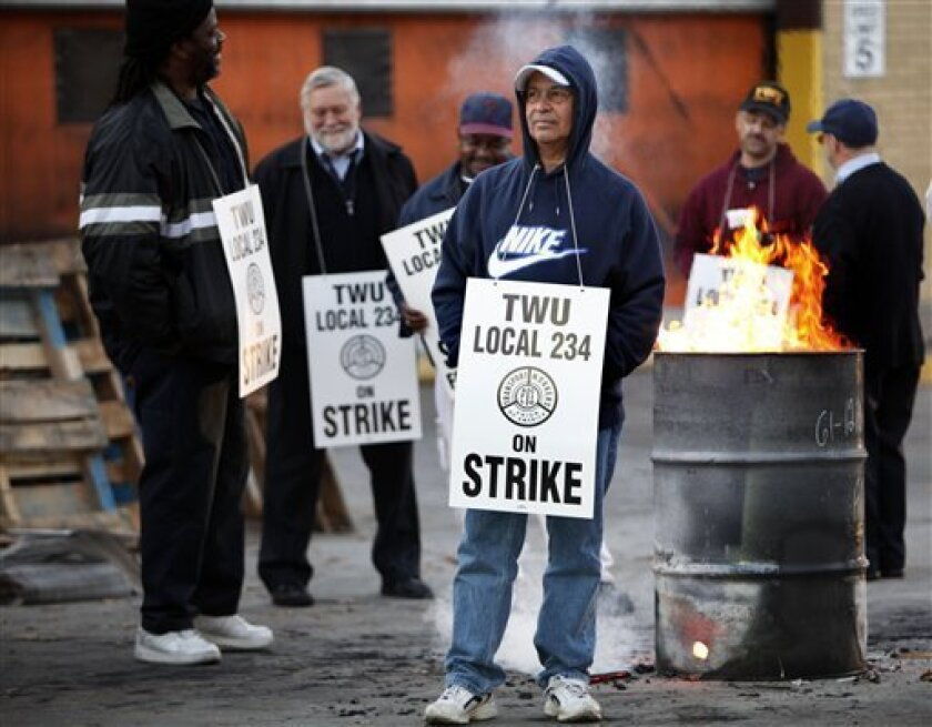 Transport workers are seen on strike at the The Frankford Transportation Center in Philadelphia, Tuesday, Nov. 3, 2009. The Philadelphia transit system's largest union went on strike early Tuesday, bringing the city's bus, subway and trolley operations to a halt a day after the World Series shifted to New York. (AP Photo/Matt Rourke)