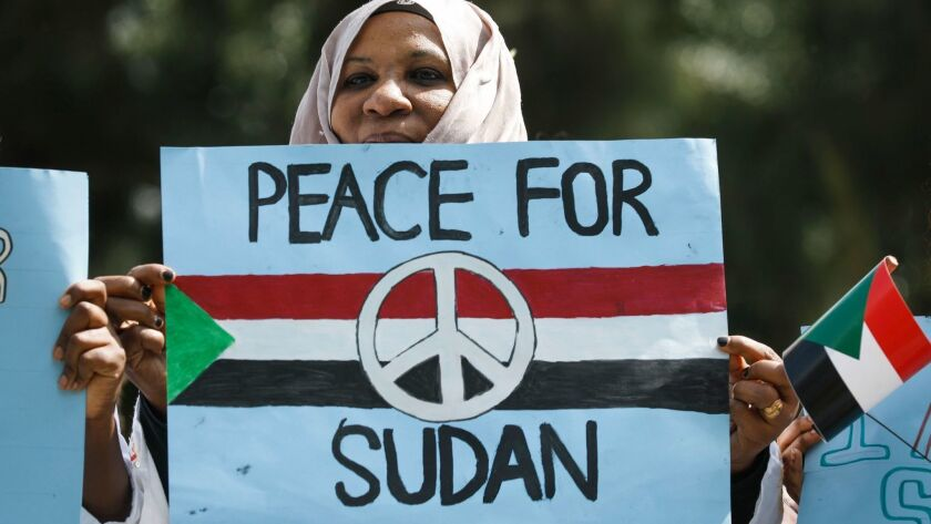 A Sudanese woman participates in a June 19 protest against Sudan's crackdown on pro-democracy protesters.