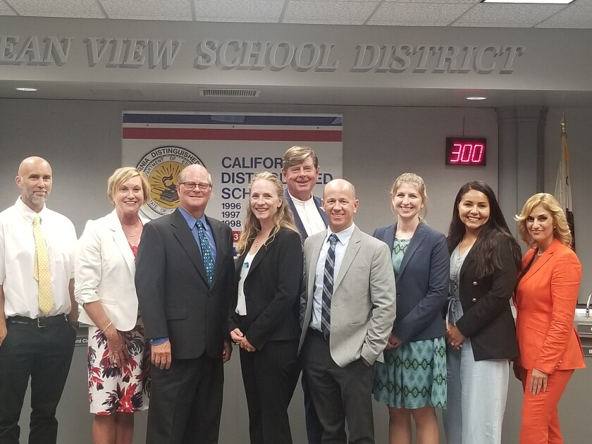 The Ocean View School District Board of Trustees poses for a photo with new principal and assistant principal appointees.