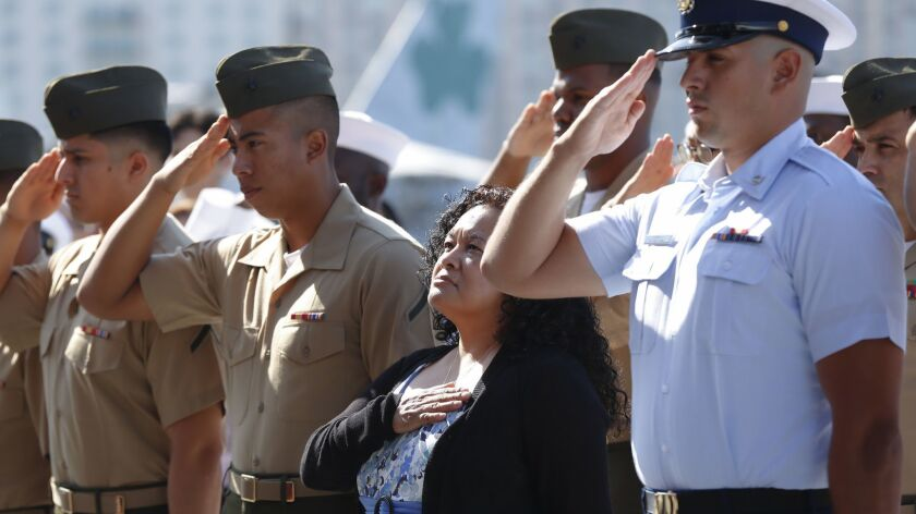 Virginia Lopez Coleman, whose husband is a veteran and daughter is active military, joins service members in becoming a United States citizen during a ceremony aboard the carrier Midway museum.