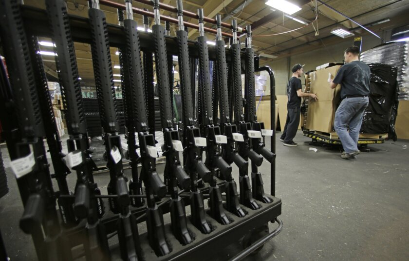 An Orange County sheriff's deputy lost his AR-15 rifle Tuesday after forgetting that he left it on the trunk lid of his car. Above, new AR-15s stand in a rack at Stag Arms in New Britain, Conn., in 2013.