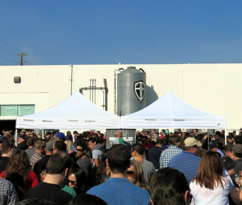 A crowd gathers in Noble Ale Works' parking lot to celebrate the brewery's third anniversary.