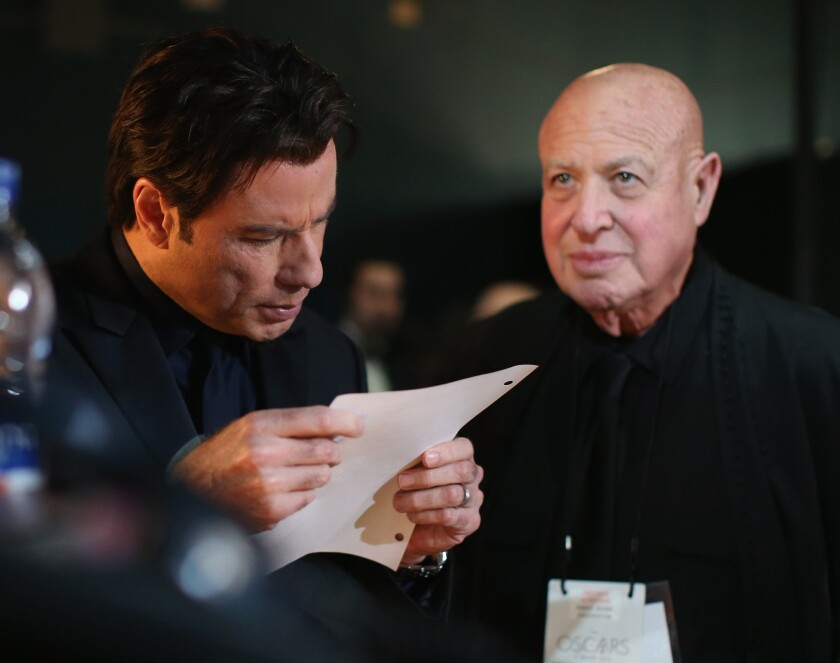 Actor John Travolta and publicist Paul Bloch are shown backstage at the 86th Oscars.