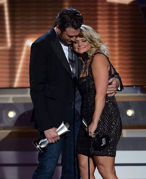 Married couple Blake Shelton and Miranda Lambert accept the song of the year award.