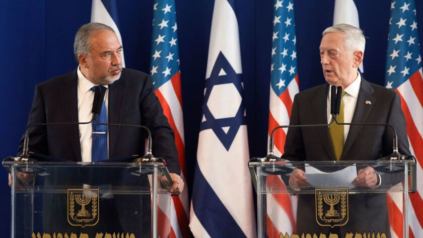 U.S. Defense Secretary Jim Mattis, right, and Israeli Defense Minister Avigdor Lieberman attend a jo