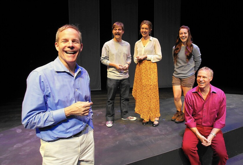 """Director Don Hill, cast members Vinny Tangherlini, Megan Gainey, Amy Tilson-Lumetta and playwright Luke Yankee, left to right, share a laugh on the set of """"Last Lifeboat."""""""
