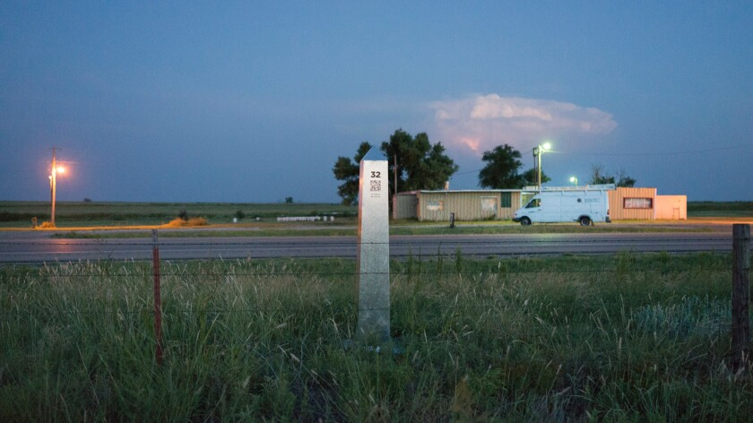 Monument #32, marking the 1821 U.S.-Mexico border, outside of Higgins, Texas — as a storm approaches.