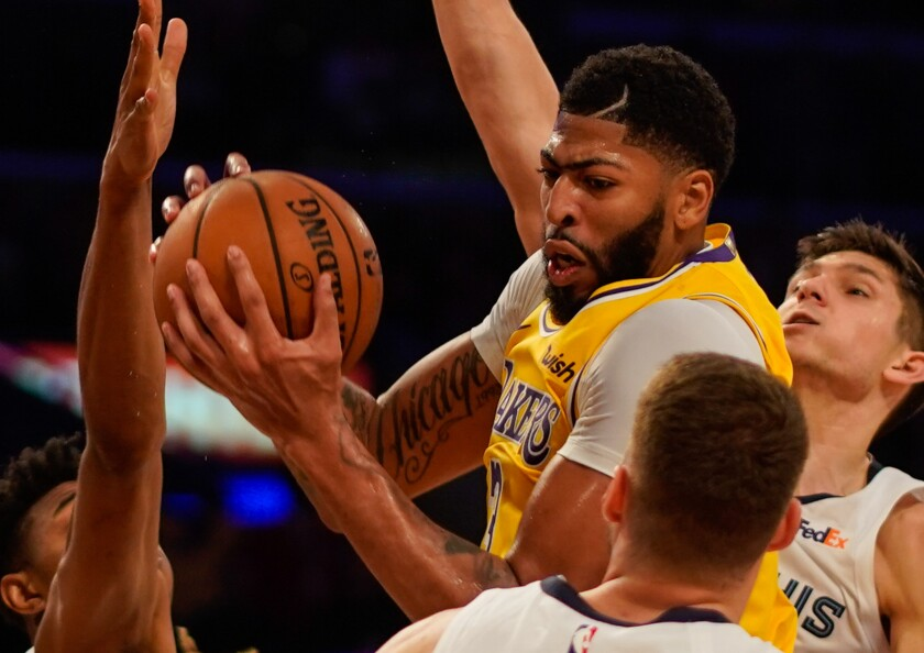 Lakers star Anthony Davis grabs one of his 20 rebounds against the Memphis Grizzlies.