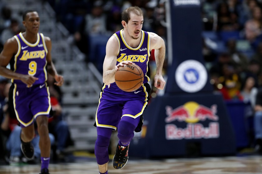 Lakers guard Alex Caruso brings the ball up court during a game against the Pelicans last season in New Orleans.
