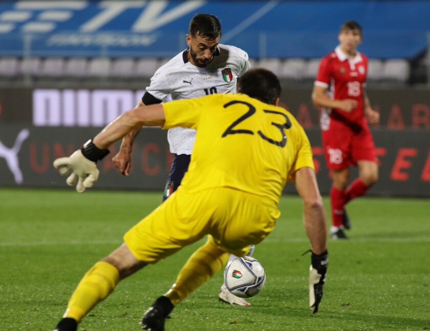 Italy's Francesco Caputo scores a goal during the international friendly soccer match between Italy and Moldova, at the Artemio Franchi stadium, in Florence, Italy, Wednesday, Oct. 7, 2020. (Marco Bucco/LaPresse via AP)