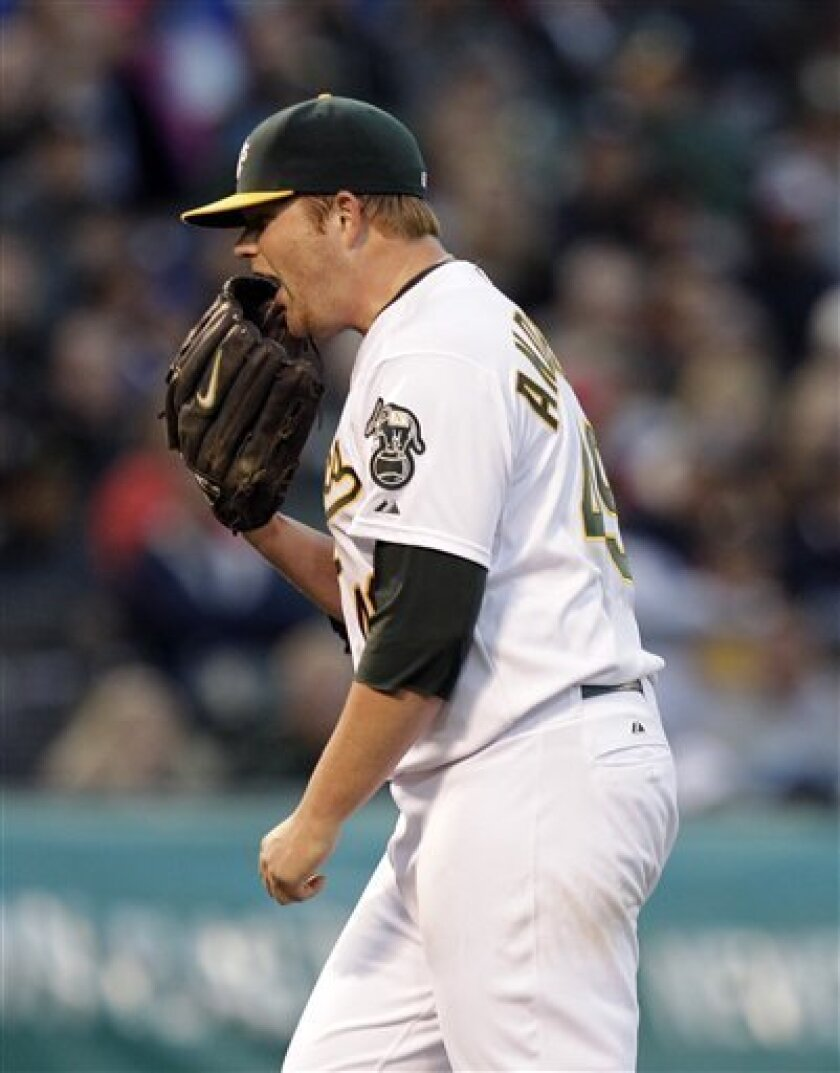 Oakland Athletics starting pitcher Brett Anderson reacts after giving up a bases-loaded single to New York Yankees' Curtis Granderson during the fourth inning of a baseball game in Oakland, Calif., Tuesday, May 31, 2011. (AP Photo/Marcio Jose Sanchez)