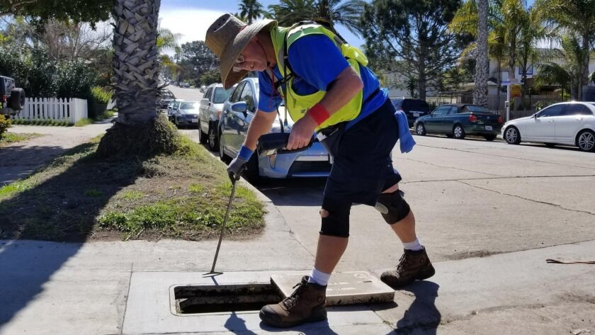 Steven Broyles, 54, a city meter reader for 18 years, working in Ocean Beach on Monday, March 19, 20