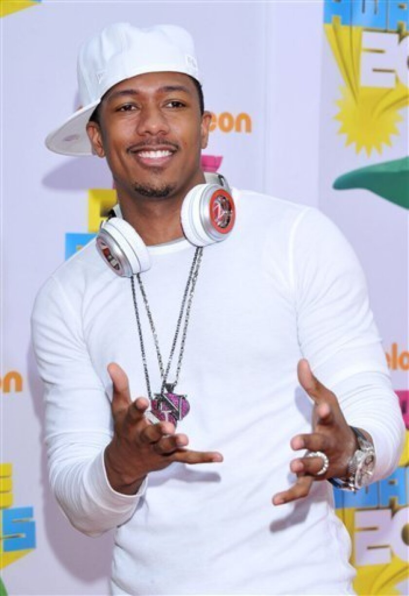 "FILE - In this April 2, 2011 file photo, entertainer Nick Cannon arrives at Nickelodeon's 24th Annual Kids' Choice Awards in Los Angeles. Cannon has been transferred to a Los Angeles hospital to continue treatment for ""mild kidney failure."" His representative says the 31-year-old Cannon was moved Wednesday, Jan. 4, 2012, after receiving treatment in Aspen, Colo., where he and his wife, Mariah Carey, had been vacationing. (AP Photo/Vince Bucci, file)"