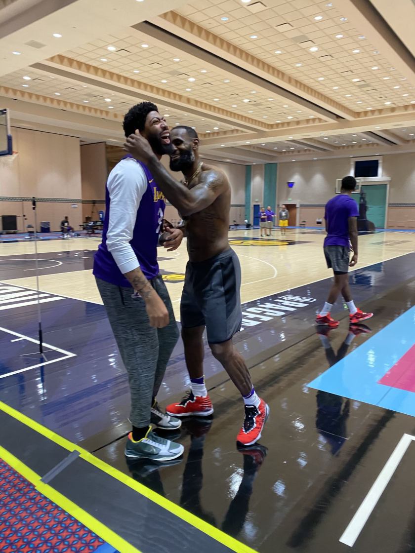 Lakers stars Anthony Davis, left, and LeBron James shares a laugh during an Orlando practice session.
