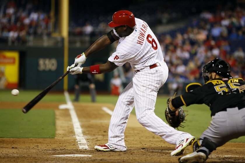 Philadelphia Phillies' Ryan Howard hits an RBI-single off Pittsburgh Pirates starting pitcher Jeff Locke during the fourth inning of a baseball game, Monday, Sept. 8, 2014, in Philadelphia. At right is catcher Russell Martin. (AP Photo/Matt Slocum)