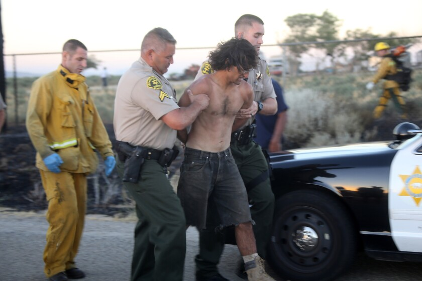 Los Angeles County sheriff's deputies arrest a man suspected of starting a brush fire in Neenach, a small community 34 miles northwest of Lancaster. The department identified the man as 27-year-old David Artiaga.