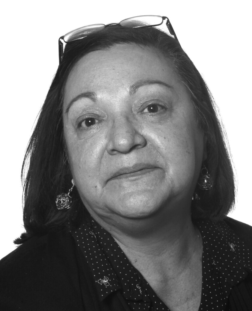 In this April 17, 2013 photo, Associated Press news editor Any Cabrera poses for a staff photo at the Mexico City AP bureau. Cabrera, a veteran AP journalist who covered many of Latin America's biggest stories during 33 years as a reporter and editor, died the morning of Monday, May 23, 2016 at her home in Mexico City. She was 60. A native of San Salvador, El Salvador, Cabrera was the Mexico-based news editor for the AP's Spanish-language service, overseeing coverage in 20 nations in Latin America, Spain and the United States. (AP Photo/Dario Lopez-Mills)