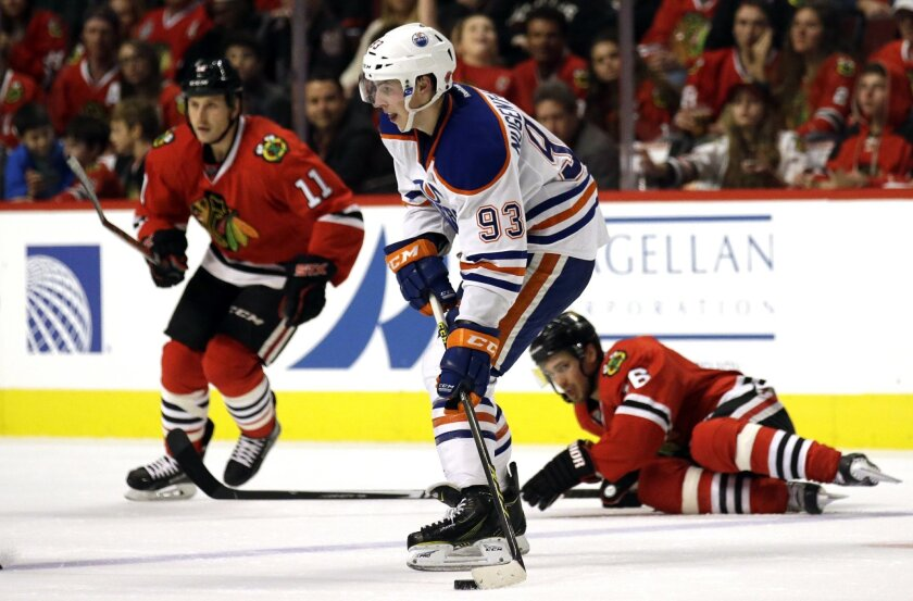 Edmonton Oilers center Ryan Nugent-Hopkins (93) looks to a pass against the Chicago Blackhawks during the second period of an NHL hockey game, Sunday, Nov. 8, 2015,  in Chicago. (AP Photo/Nam Y. Huh)