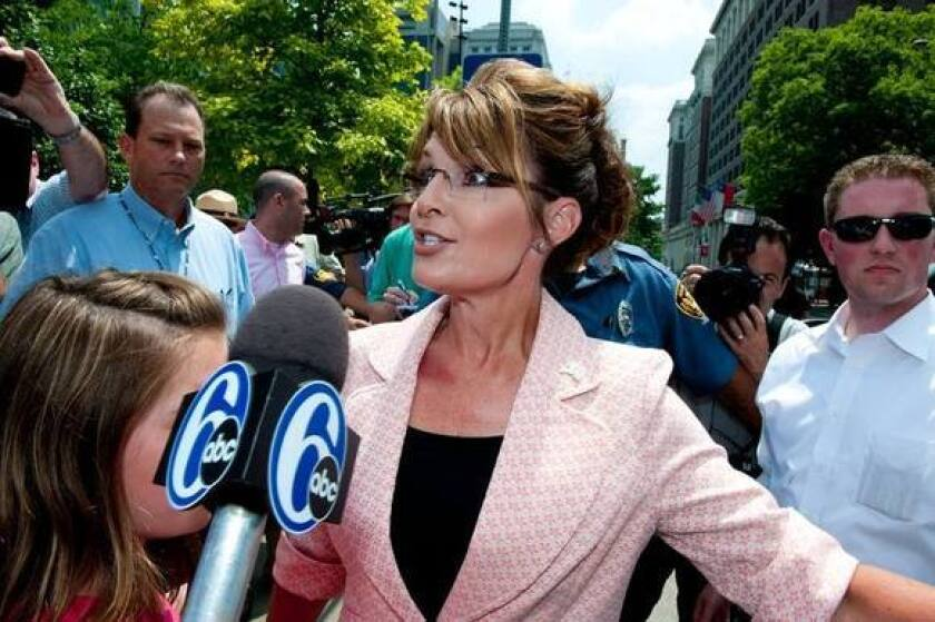 """Sarah Palin speaks with reporters outside the Liberty Bell Center during her """"One Nation"""" bus tour May 31, 2011 in Philadelphia."""