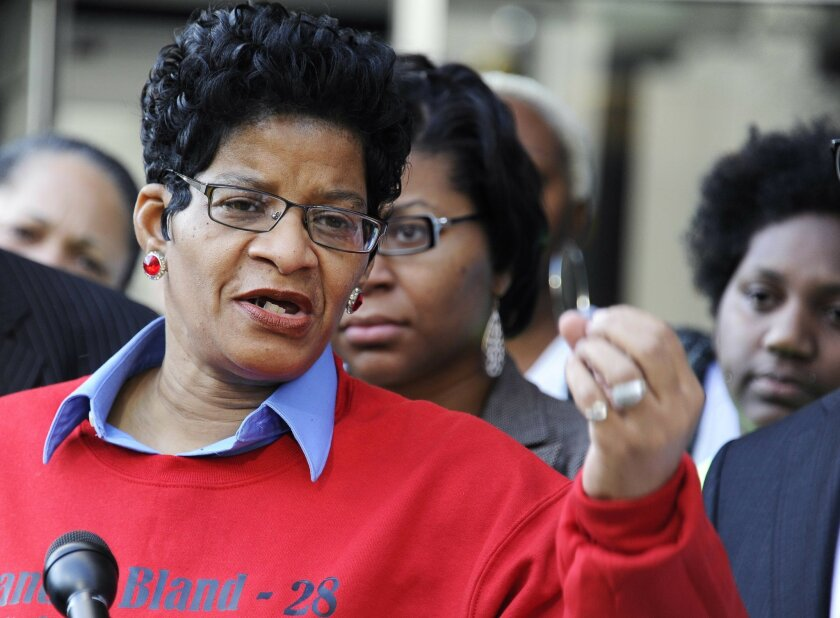 Geneva Reed-Veal, mother of Sandra Bland, who were found dead in a Texas county jail three days after a confrontation with a white state trooper, speaks to the media as she leaves the federal courthouse Thursday, Feb. 18, 2016, in Houston. A federal judge heard arguments Thursday on whether to delay a wrongful death lawsuit Bland's family has filed until the Texas state trooper who arrested her last summer is tried on a criminal charge. (AP Photo/Pat Sullivan)