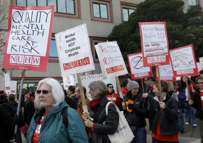 Hundreds of mental health professionals picketed outside a Kaiser Permanente facility last month calling for increased staffing of therapists and psychiatrists.