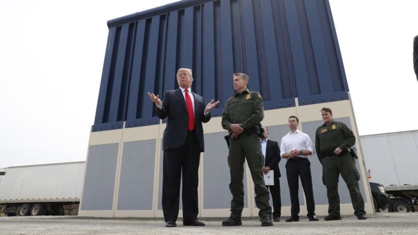 President Trump tours border wall prototypes near San Diego in March.