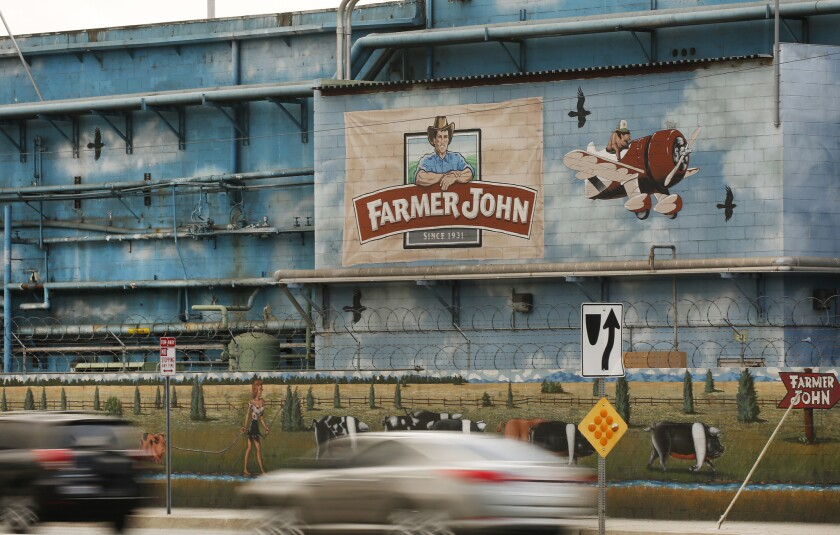 The Farmer John plant, producer of the Dodger Dog, is among the facilities that have reported COVID-19 outbreaks.