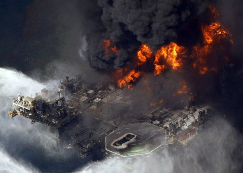 The Deepwater Horizon oil rig burns in the Gulf of Mexico off the Louisiana coast.