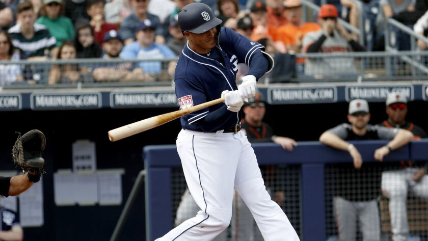 San Diego Padres' Manny Machado hits against the San Francisco Giants during the first inning of a s