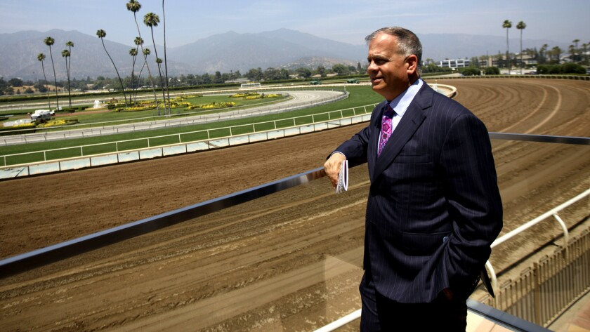 Tim Ritvo, chief operating officer of the Stronach Group, looks from the Eddie Logan Suite on a race day at Santa Anita Park last summer.
