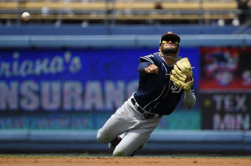 Padres shortstop Fernando Tatis Jr. throws out the Dodgers' Austin Barnes after making a diving grab on July 7.