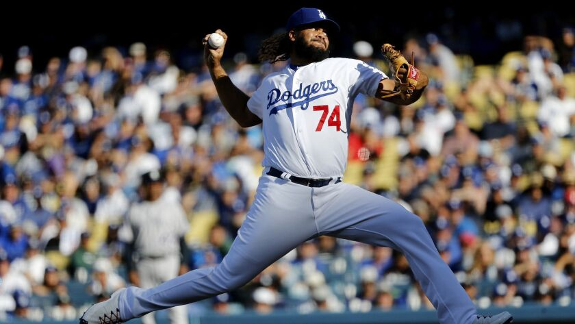 Dodgers relief pitcher Kenley Jansen delivers a pitch in the ninth inning against the Colorado Rockies in a National League West tiebreaker game played at Dodger Stadium.