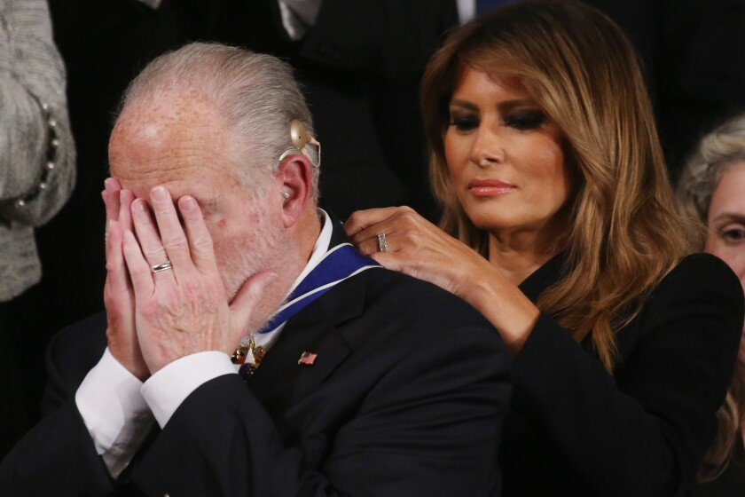 First Lady Melania Trump drapes Rush Limbaugh with the Presidential Medal of Freedom at the State of the Union on Feb. 4, 2020.