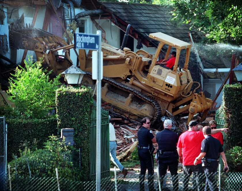 A bulldozer tears into the former home of O.J. Simpson in Brentwood in 1998.
