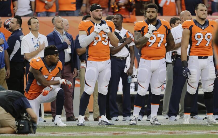 Broncos linebacker kneels during national anthem in season opener