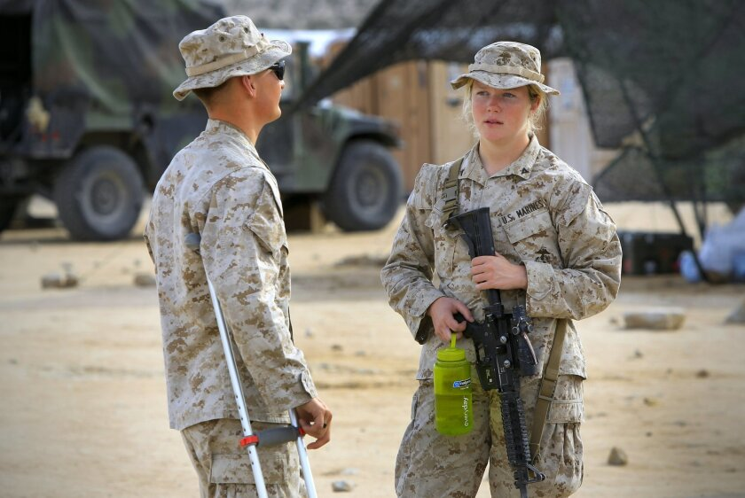 Lance Cpl. Callahan Brown, right, and another Marine in the Ground Combat Element Integrated Task Force, during combat trials to determine if women should serve in ground combat units.