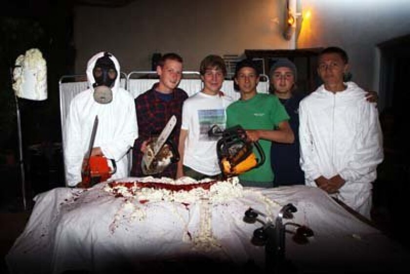 La Jolla high school students and members of the Interact Club Thomas McBee, Tom Wheeler, Nick Wagener, Matt Twohig, Trevor Knox and Kevin Riley worked on Bird Rock's Haunted House. Photo: Pearl Preis