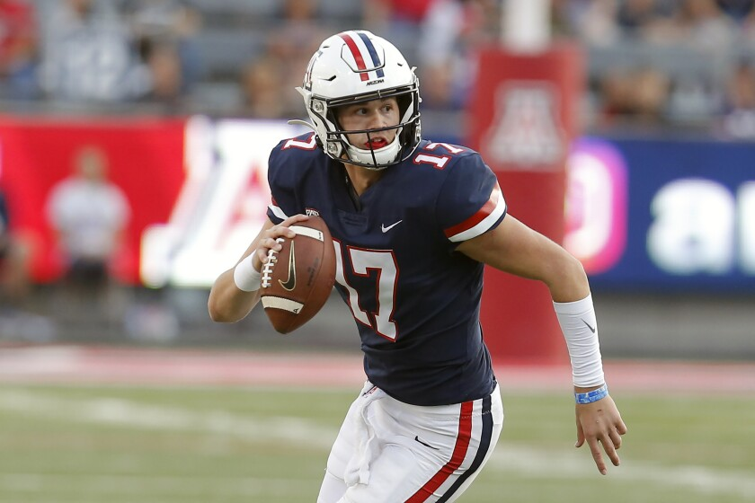 Arizona quarterback Grant Gunnell (17) is shown during the second half of an NCAA college football game against Oregon State, in Tucson, Ariz. Arizona State has some talent back on offense this season, led by sophomore quarterback Jayden Daniels. (AP Photo/Rick Scuteri)