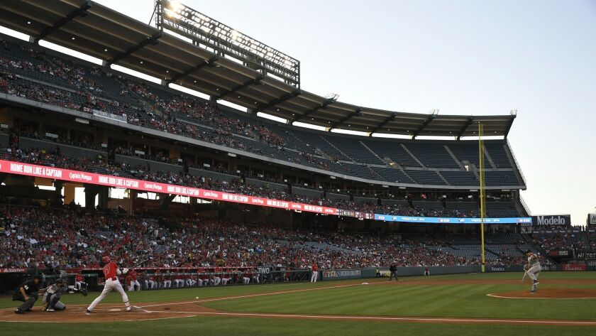 Angels designated hitter Shohei Ohtani hits a single against the Seattle Mariners on June 8. If the team chooses to renovate Angel Stadium, the city of Anaheim isn't expected to offer part of its general fund to cover costs.