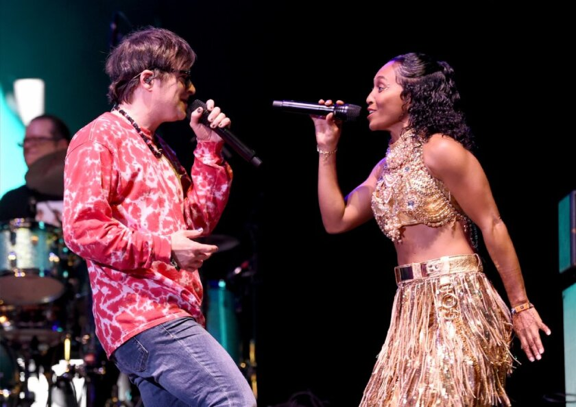 """Rivers Cuomo of Weezer (left) and Rozonda """"Chilli"""" Thomas of TLC perform at Coachella on April 13."""