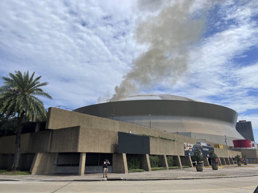 This photo provided by New Orleans fire department shows smoke coming from roof at New Orleans' Superdome on Tuesday, Sept. 21, 2021 in New Orleans. The New Orleans Fire Department says it responded to a fire about 1 p.m. Tuesday on the roof. A short time later it appeared under control. (Chief C Mickal/New Orleans Fire Department via AP)