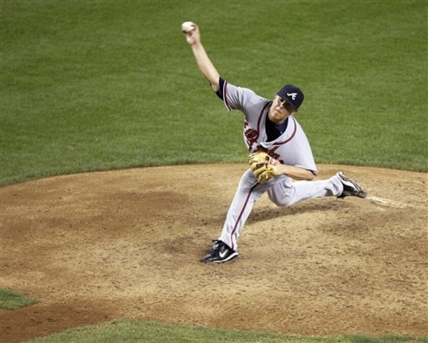 Atlanta Braves' Kris Medlen releases a pitch against the Arizona Diamondbacks in the sixth inning of a baseball game, Sunday, May 31, 2009, in Phoenix. Medlen pitched seven innings, giving up just one run on four hits. (AP Photo/Paul Connors)