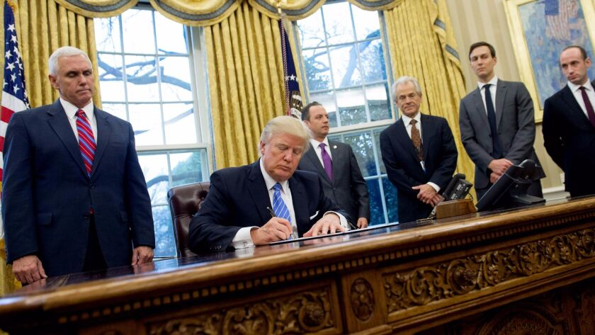 (FILES) This file photo taken on January 23, 2017 shows US President Donald Trump signing an executi